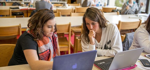 two female students studying in library