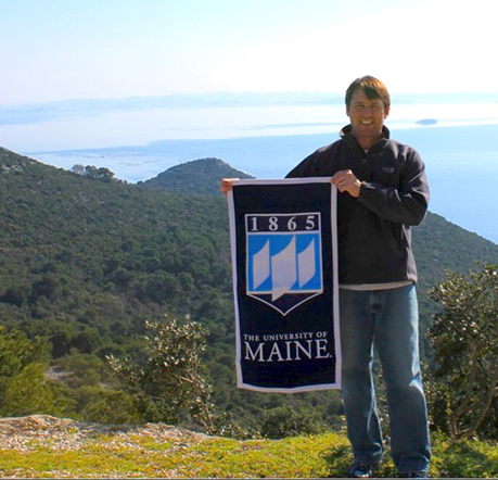 Student in Croatia with UMaine flag