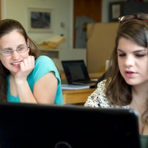female students at the UMaine Writing Center