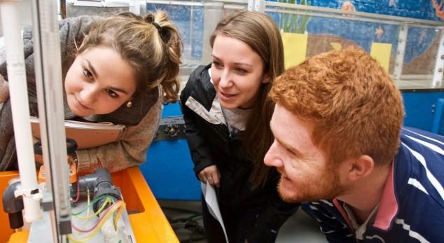 three students in hydraulics lab