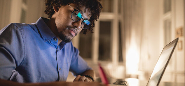 student studying at home with laptop